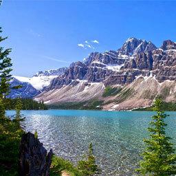 alberta lake mountains snow pine trees scenery